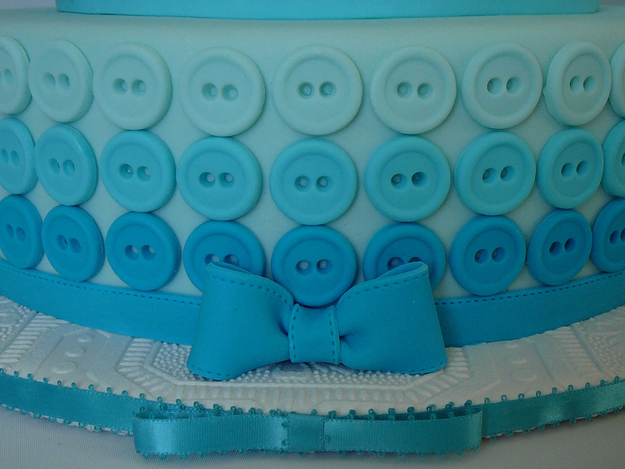 c0ff4ad7dc44 Converse and buttons shower cake. I also made baby clothing to put on a  clothes line on the second tier of the cake. Vanilla cake with buttercream  and ...