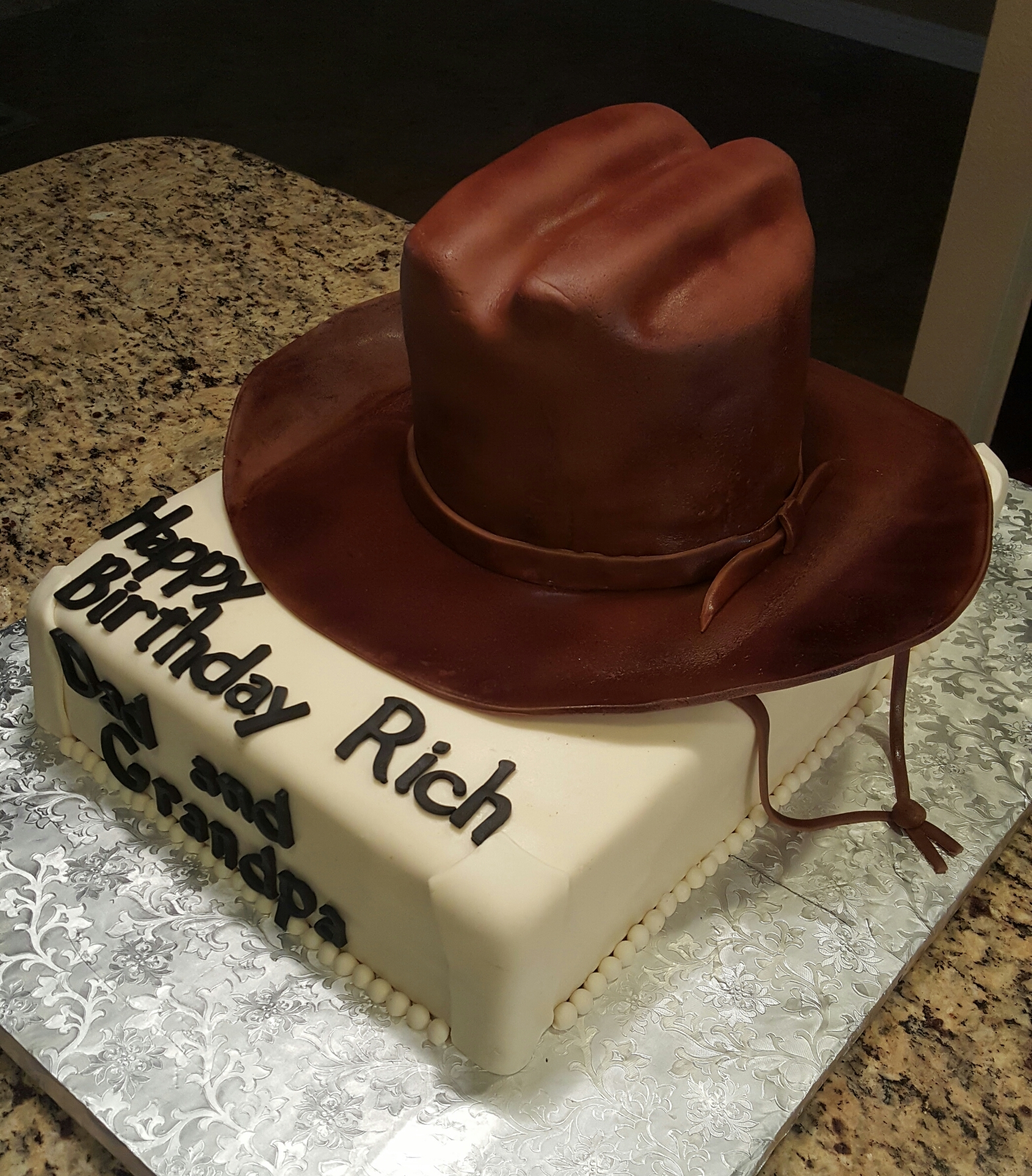 First Cowboy hat cake covered in fondant ontop of fondant 1 2 sheet covered  cake...first time using my new airbrush machine on the hat. c2ddf36c418