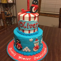 "2 Tier Onederland Cake 2 tier round birthday cake. Theme was ""Onederland"" Buttercream frosting with fondant embellishments."