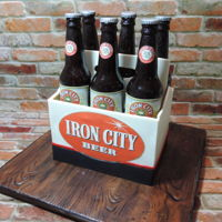 6 Pack Of Beer Cake All edible! Bottles are made from sugar, the panels are fondant, and the inside is all cake :-)