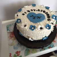 60Th Birthday Cake   Color scheme blue, black & white. Simple flowers & heart made of gumpaste.