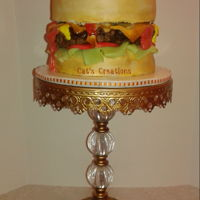 All Dressed Burger Burger cake: fondant lettuce, cheese, bacon. Ketchup, mustard made with vanilla frosting, relish with frosting with bits of gummies. Patty...
