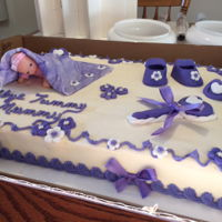 Baby Shower Cake Customer wanted all purple accents. All accents except the baby was made of fondant.