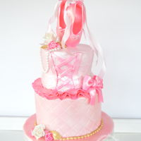Ballerina Ballerina theme cake, pink slippers, corset, tutu, pearls, bows, and roses.