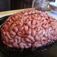 Brainssssss! Red Velvet Cake with Swiss Meringue buttercream and covered with marshmallow fondant then brushed with melted raspberry jam