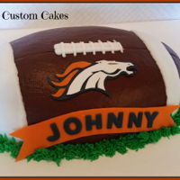 Broncos Football Cake Cake made for super bowl/birthday party. Chocolate bc, fondant logo