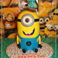 Buttercream Minion Minion cake - all yellow is buttercream icing. Fondant was used for the overalls, hands, legs, fee, eye and goggle/headband. Cupcake is an...