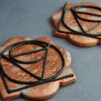 Copper And Wrought Iron Look Love Cookies Lustre dusts cookies with the iconic Dirk Bell LOVE Symbol piped in Royal Icing.