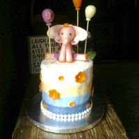 Edie Is Three Tall little cake for 3 year old girl. Cake is covered in 4 buttercream colors for an ombré effect. Elephant, balloons, and...