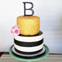 Elegant Bridal Shower Cake Gold sequins and black and white stripes. Flowers and initial are made from gumpaste.