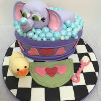 Elephant Takes A Bubble Bath I made this cake just for fun. It was a dark chocolate cake with chocolate filling and vanilla bean buttercream. The elephant and rubber...