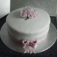 Flower Cake   Flower cake with pink ribbon.