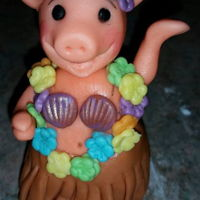 Fondant Luau Pig This was a little fondant pig I made for a small cake at a luau. I formed the pig out of fondant. I used a mold for the shell top and the...