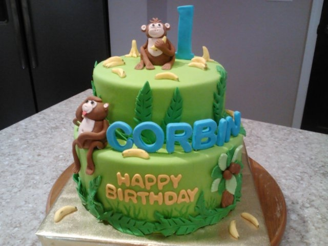 Fondant Monkey Banana Cake Hand molded monkeys and bananas with fondant.