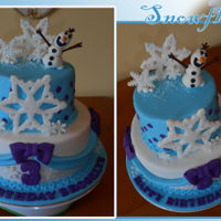 Frozen Cake 2 tiered cake, covered in fondant, sugar sprinkles on fondant snowflakes, olaf made of fondant as well.