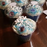 Frozen Cupcakes Frozen Cupcakeswith chocolate snowflakes and blue sugar sprinkles
