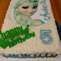 Frozen Elsa   Vanilla and Chocolate cake with buttercream and Elsa image topper