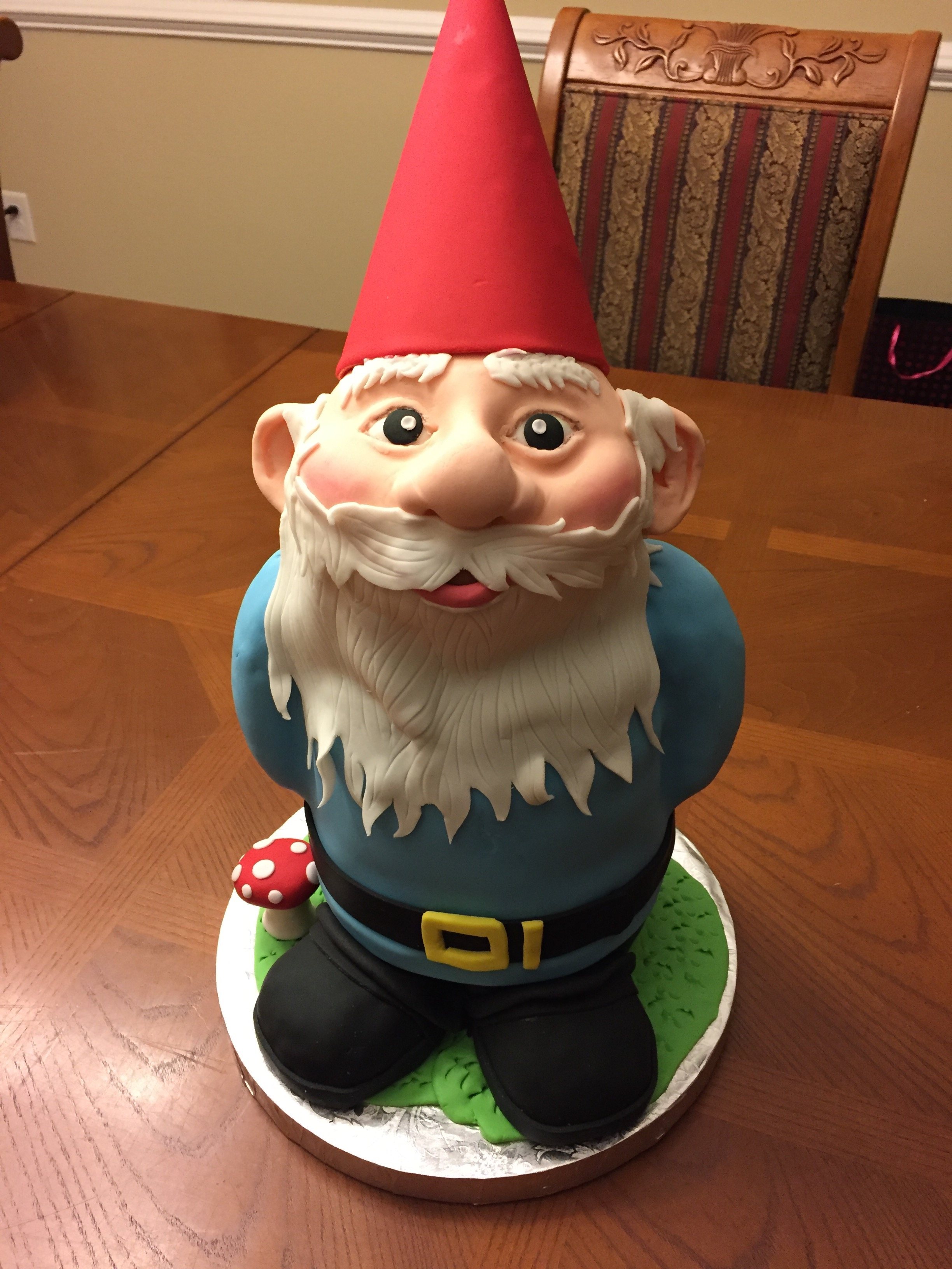 "Gnome Cake This is tall cake (17"") made of red velvet with cream cheese frosting. The body is cake and the arms, legs, and head are cereal treats..."