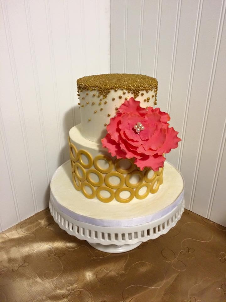 Gold Rings And Dragees With A Pop Of Coral Buttercream with fondant rings, gold dragees, and a coral gumpaste fantasy flower