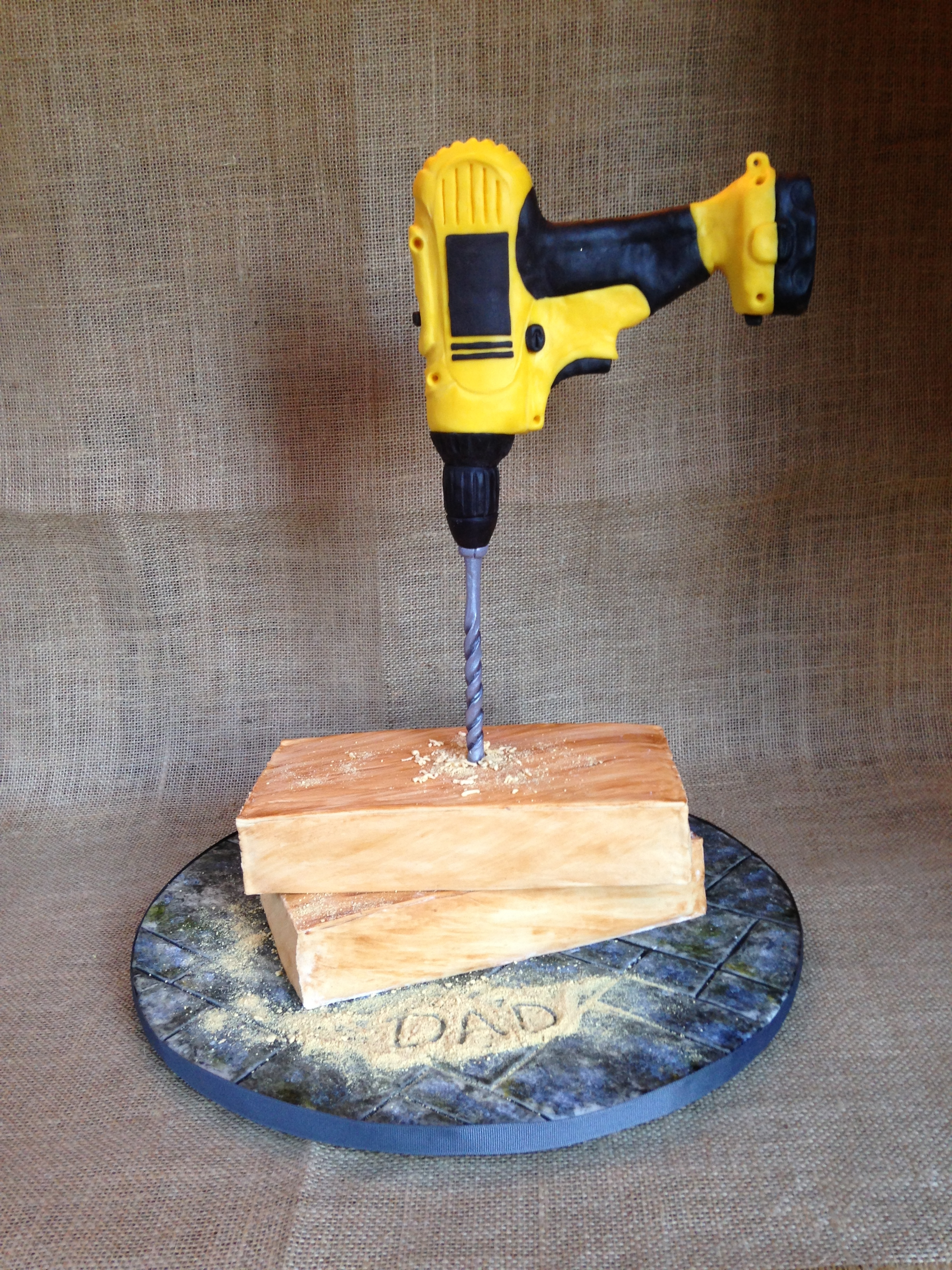 Gravity Defying Drill Cake Drill hand molded of modeling chocolate. Wooden planks are cake covered in mmf. The base is mmf made to look like tile by hand and hand...