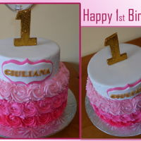 Happy 1St Birthday 2 tiered cake. top tier covered in fondant with diamond pattern and name plate, bottom tier covered in buttercream rosette ombre. #1 is...