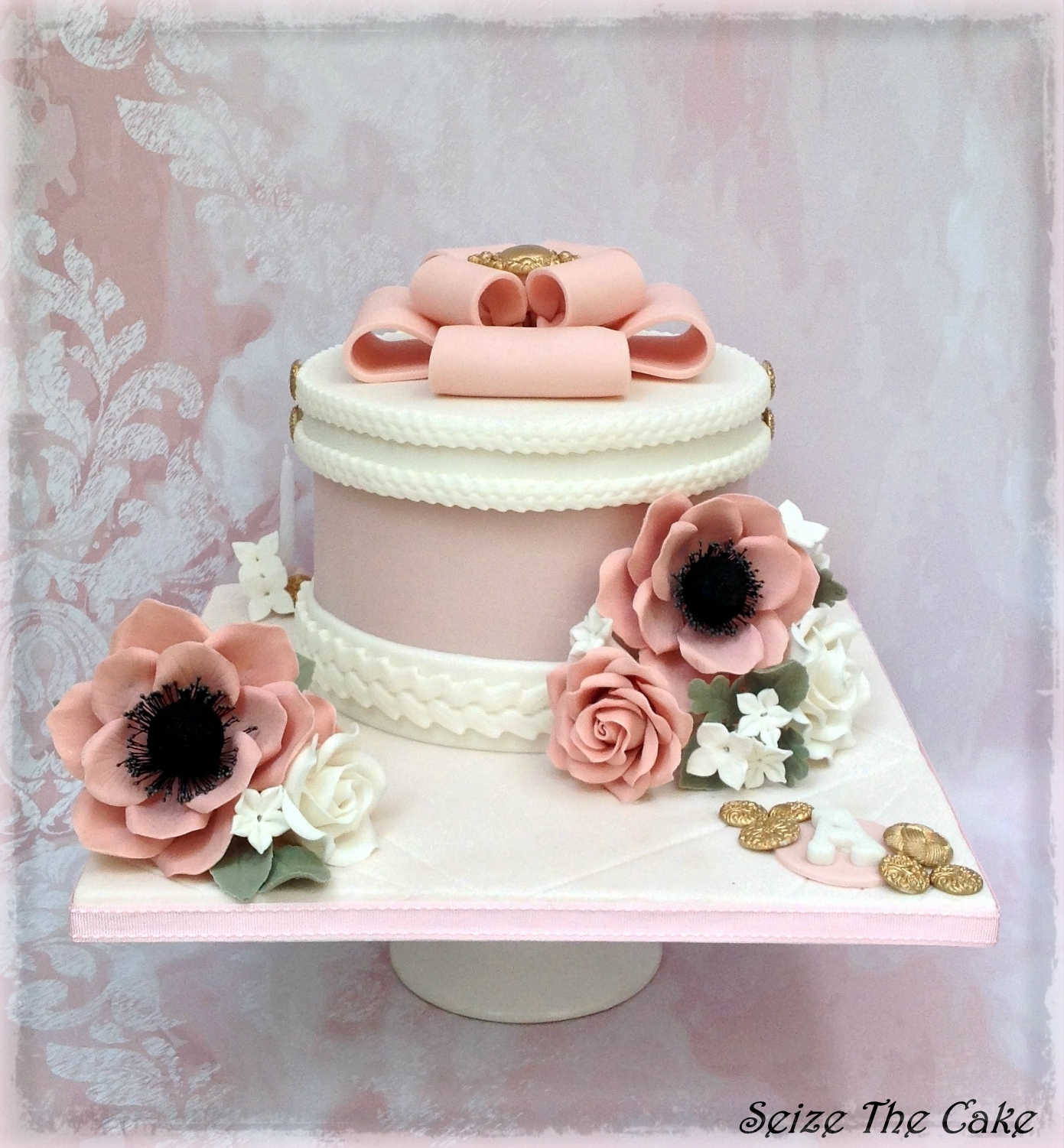 Hatbox Birthday Cake Romantic and classy Hatbox Birthday Cake decorated with handmade sugar anemones and roses.