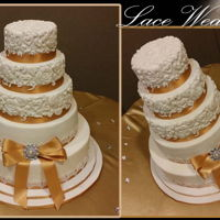Lace Mold Wedding Cake 4 tiered cake. Covered in fondant with sugar veil lace over satin gold ribbon. Used rose mold for the top 3 tiers.