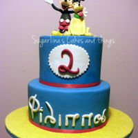 Mickey Mouse And Pluto two victoria chocolate cakes filled with kinder bueno cream!! Mickey and Pluto are handmade figures.