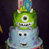 Monsters Inc. I made this for my grandson's third birthday. The top tier was strawberry cake, his favorite, just for him.