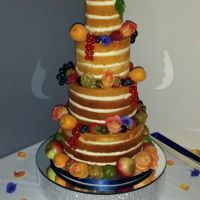 Naked Wedding Cake Made using edible flowers and fresh fruit which was in season