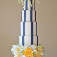 Nautical Wedding Cake This Nautical wedding cake took inspiration from a lighthouse. The brides mood board included blue striped linens with grey piping and a...