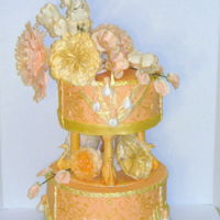 Peach And Gold Gumpaste roses, peonies, irises, and sweet peas were put on a fondant cover dummy cake. Thanks to everyone who posted tutorials. I've...