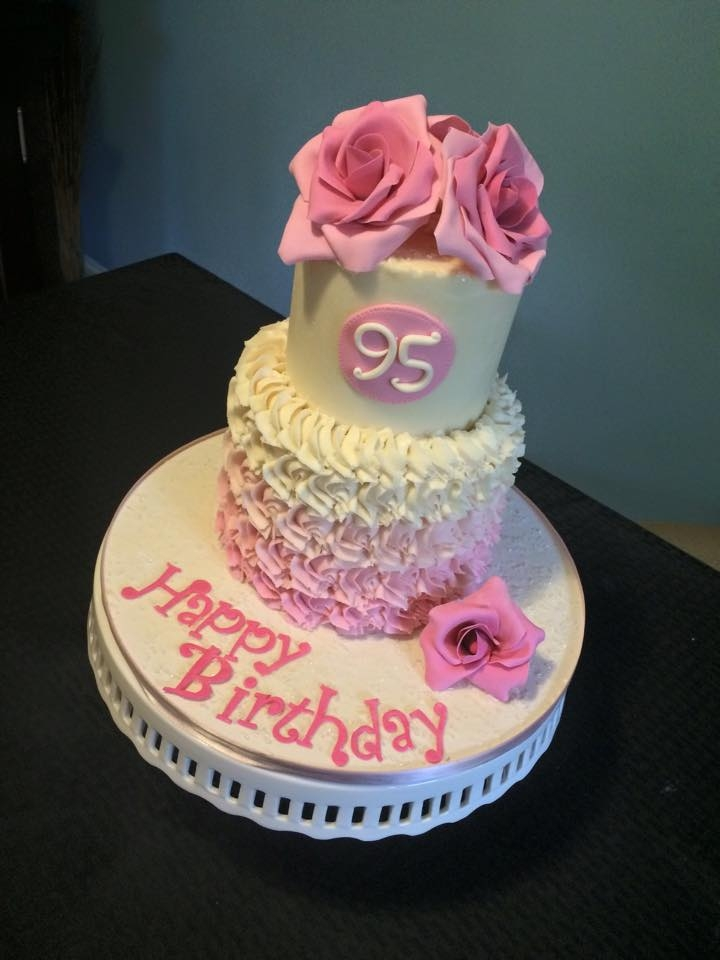 Pink Roses & Ombre Rosettes 95th birthday cake. Ombre buttercream rosettes topped with gumpaste roses.