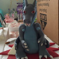 Pokeman Dragon Topper Dragon made for the top of a 5 year old boy's birthday cake. Made of RKT & covered with fondant.