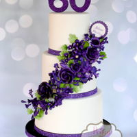 Purple Floral Cascade Cake This was my first time making a cake that featured sugar flowers. I have never been so nervous as I was punching that first flower through...