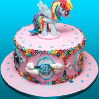 Rainbow Dash Cake Chocolate layer cake for a little boy who loves My Little Pony. Rainbow Dash is made from fondant + cmc. Cake is filled with raspberry...