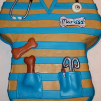Scrub Shirt Cake White cake with Caramel icing, fondant stripes and stethoscope, pin, bones and scissors.