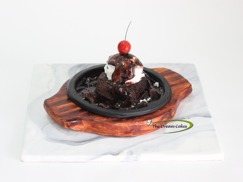 Sizzling Brownie Its not everyday you get to work on such fun cakes. A 14 year old princess gave me this opportunity for her birthday! A completely edible...