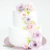 Soft Hues Soft HuesA rustic fresh whipped cream engagement cake adorned with gumpaste subtle colour Roses.