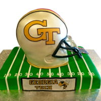 Two Sided Football Helmet Grooms Cake Georgia Tech/Ohio State football helmet; red velvet and vanilla cake
