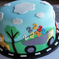 "Two Year Old's Birthday Cake Small 6"" round cake with cars, a school bus and a dump truck full of two's!"
