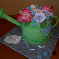 Watering Cane Made this for my sister n law who loves gardening. Covered in fondant, spout made using plastic dowel, handle is fondant. Sugar flowers on...