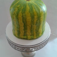 Watermelon Cake Pink velvet with chocolate chips and duncan hines watermelon icing. Fondant covered and hand painted.