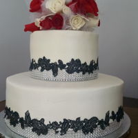 Wedding Cake Wedding cake for a friend. Buttercream cake with gumpaste roses, black cake lace. Thanks for looking.