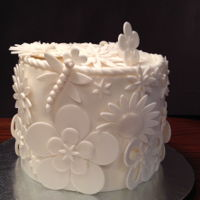 White On White Petite cake made for someone who loves dragonflies. Elements made from gumpaste.
