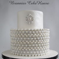 White Wedding Cake very small simple but elegant wedding cake. all is eadible