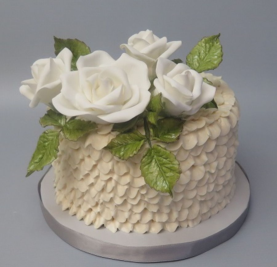 Buttercream Ruffles And White Sugarpaste Roses on Cake Central