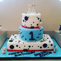 101 Dalmatians 101 Dalmatians Birthday Cake. Blue and white tiers with red dog collars on top and bottom tiers.