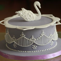 2 D Royal Icing Swan extension work on a dummy cake with royal icing swan