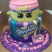 "2 Tier Shopkins Cake With Soda Pop  2 Tier Shopkins Cake with Soda Pop8"" Top Tier: Marble (Strawberry/Orange) Cake10"" Bottom Tier: Marble (Yellow/Chocolate) Cake in..."